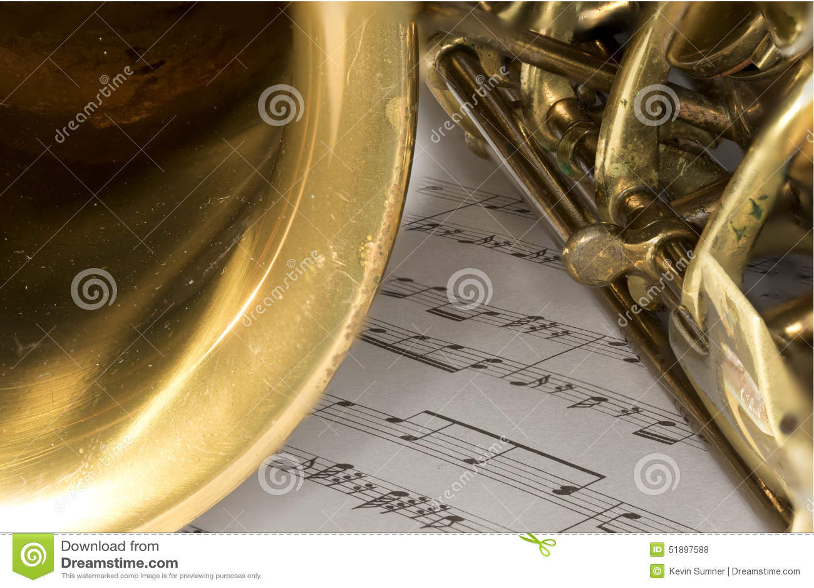 Macro Shot Of Tenor Saxophone On Sheet Music Stock Photo