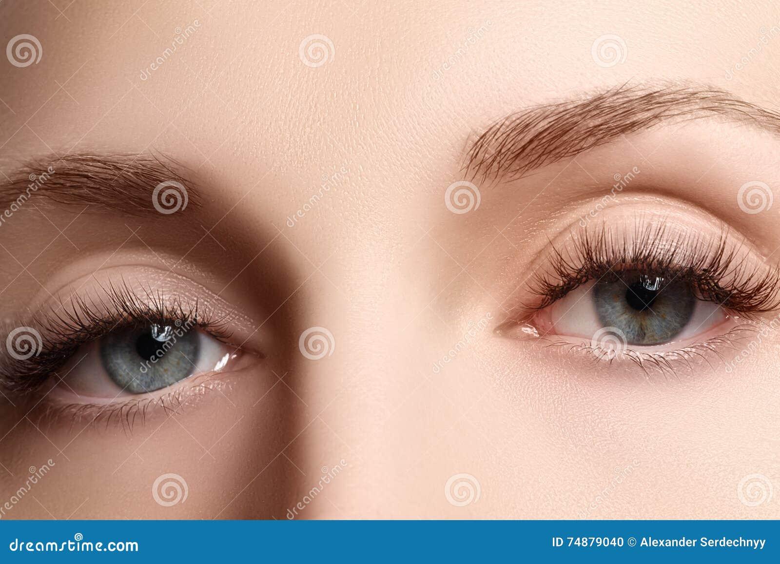 Macro shot of woman`s beautiful eye with extremely long eyelashe