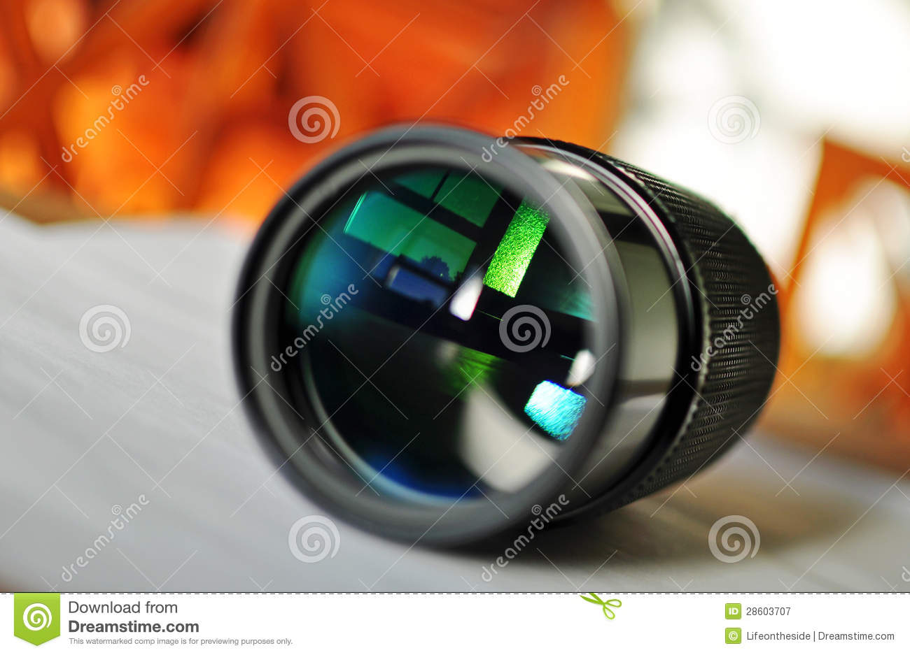 macro of a slr camera zoom lens reflecting window royalty