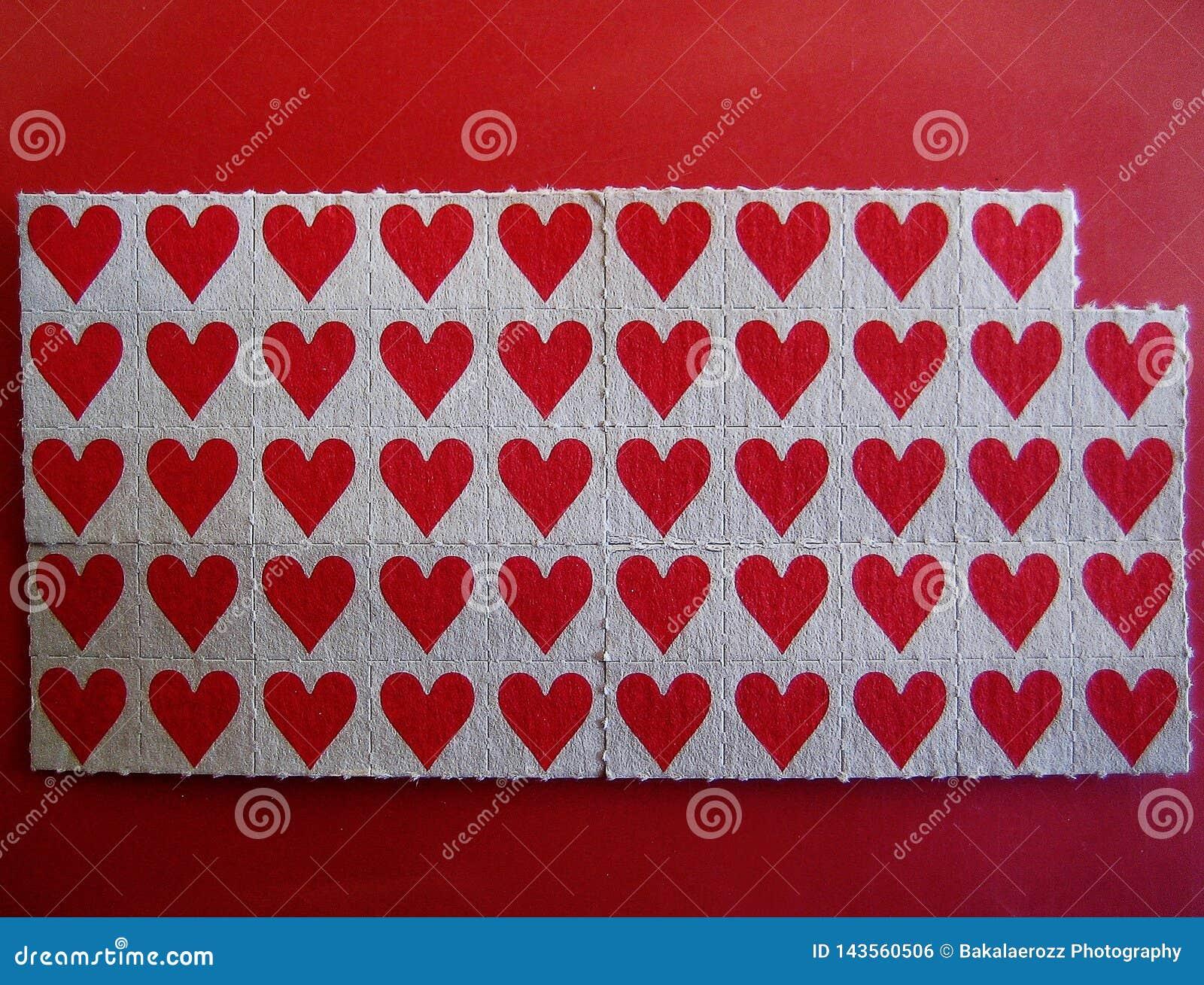 Macro stampe fini della carta da parati del piccolo del bastone fondo rosso delle carte