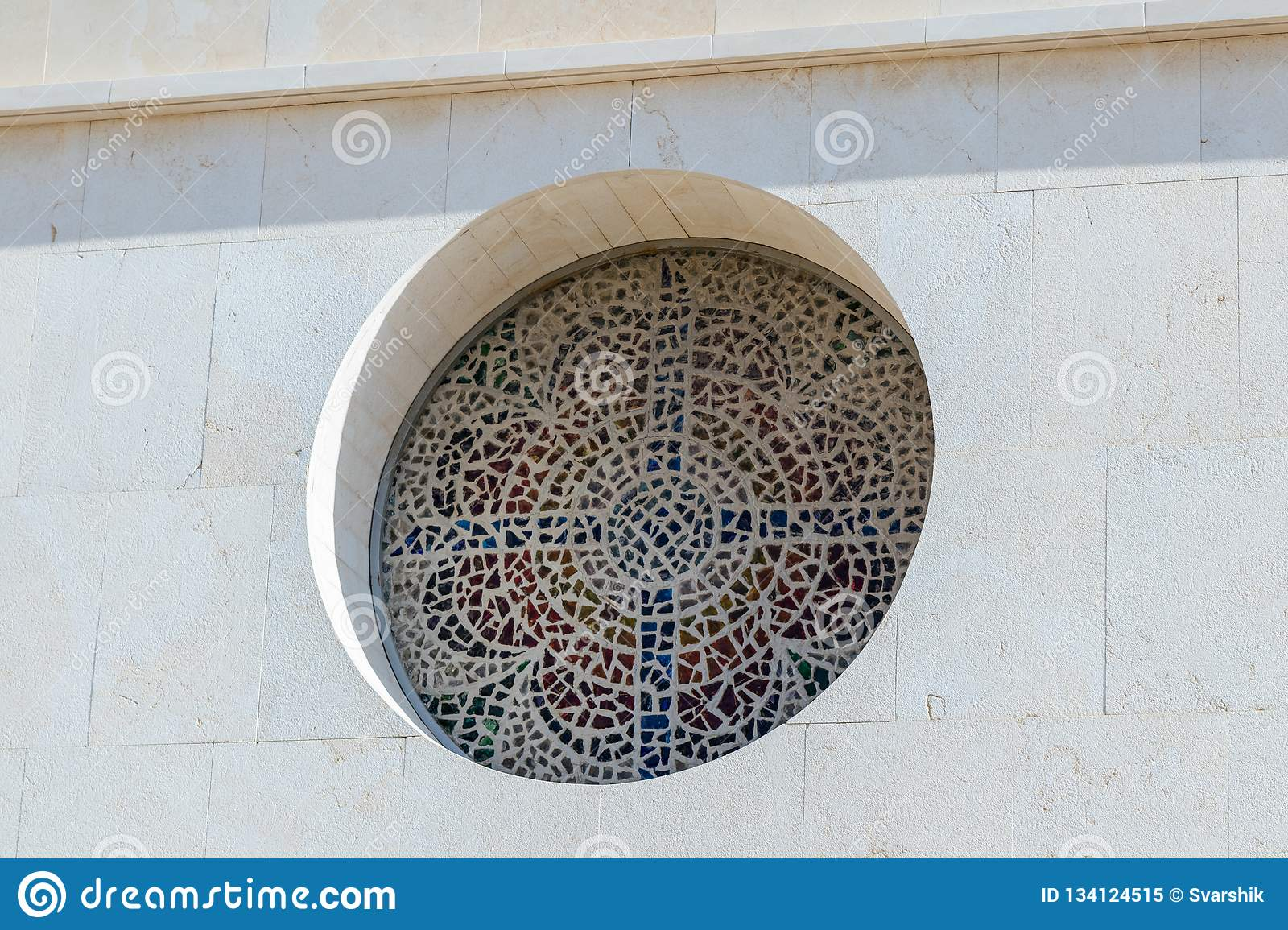 Stained glass window in the form of a cross in Memorial Church of Moses on Mount Nebo near the city of Madaba in Jordan