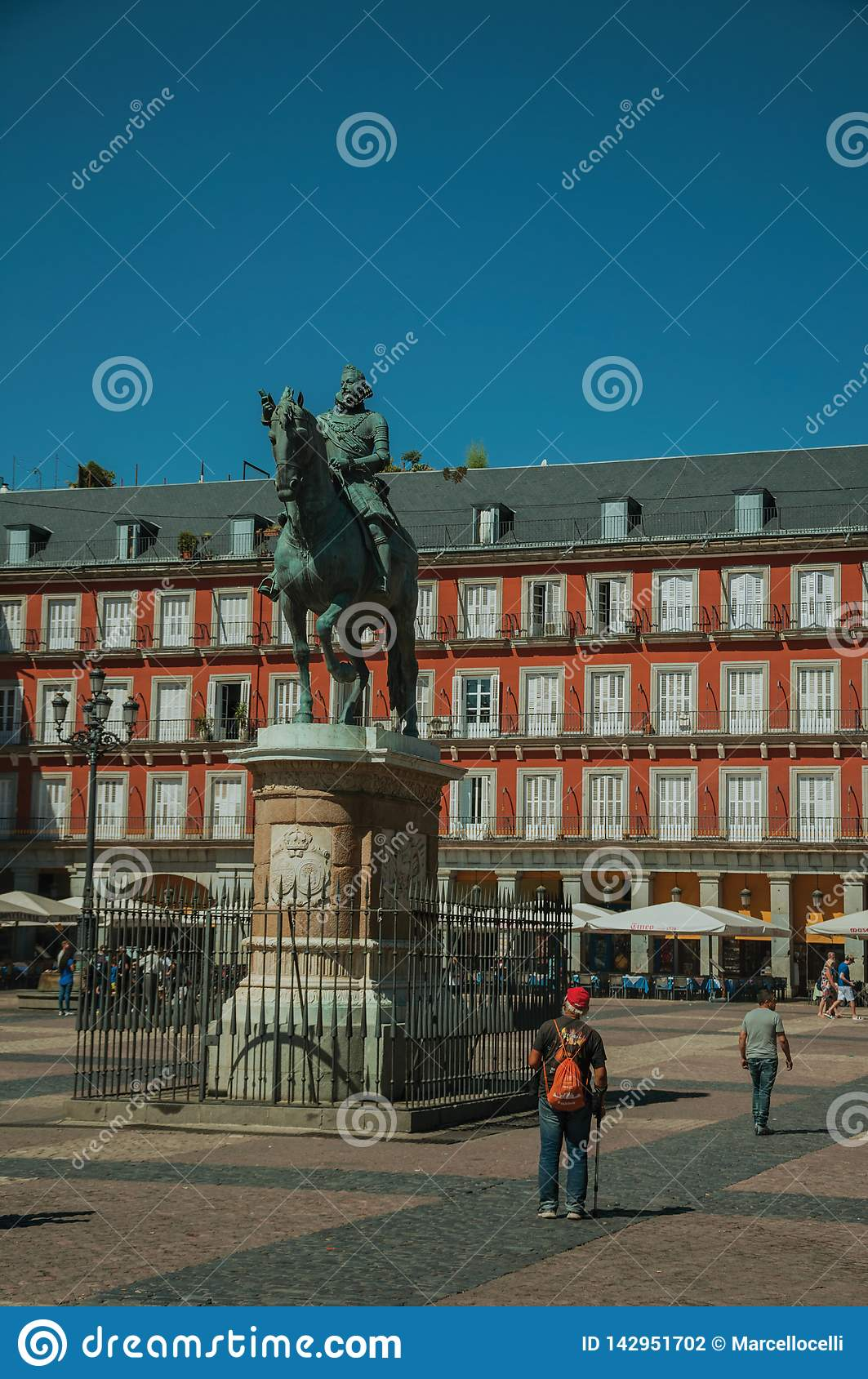 People on the Plaza Mayor with the statue of King Philip III in Madrid
