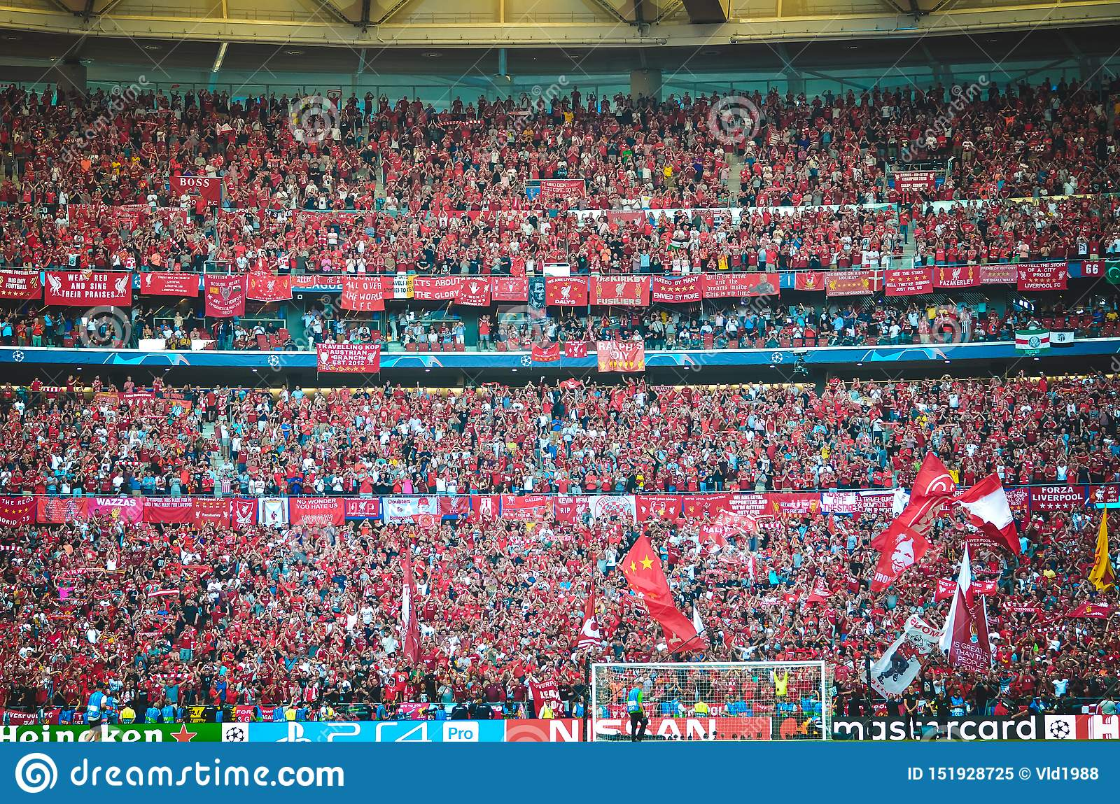 Madrid, Spain - 01 MAY 2019: Liverpool fans in the stands support the team during the UEFA Champions League 2019 final match