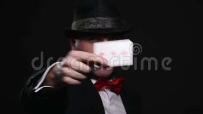 Magic, card tricks, gambling, casino, poker concept - man showing trick with playing cards