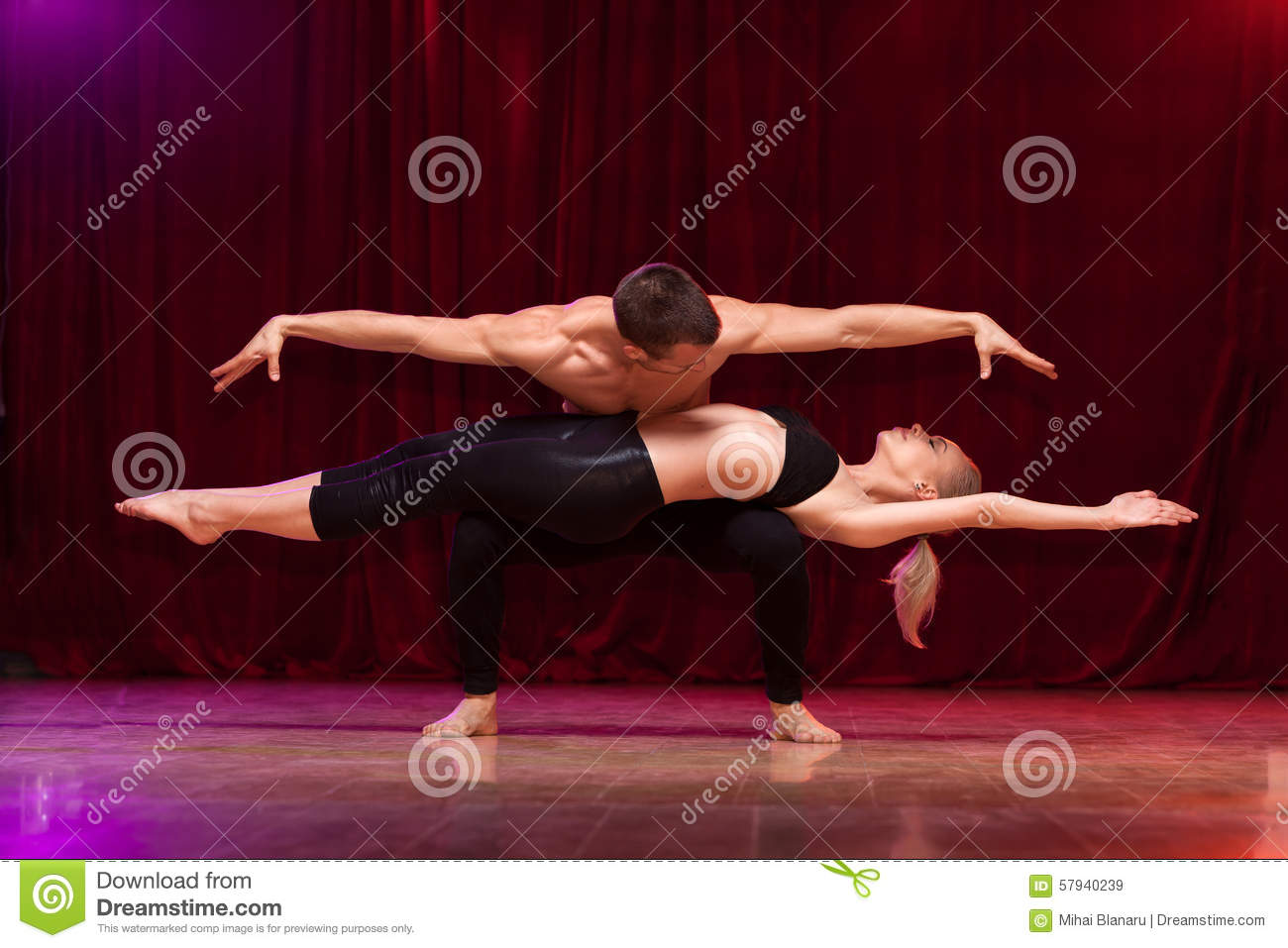 Balanced pose of an athletes couple performing an artistic duet.