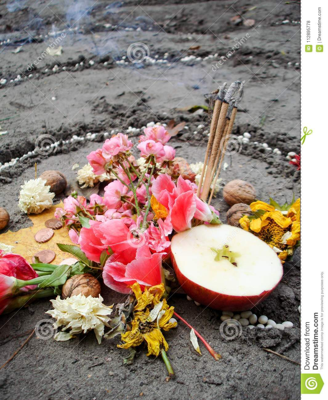Magic spiral works next to a lake, wicca altar. Pagan religion.