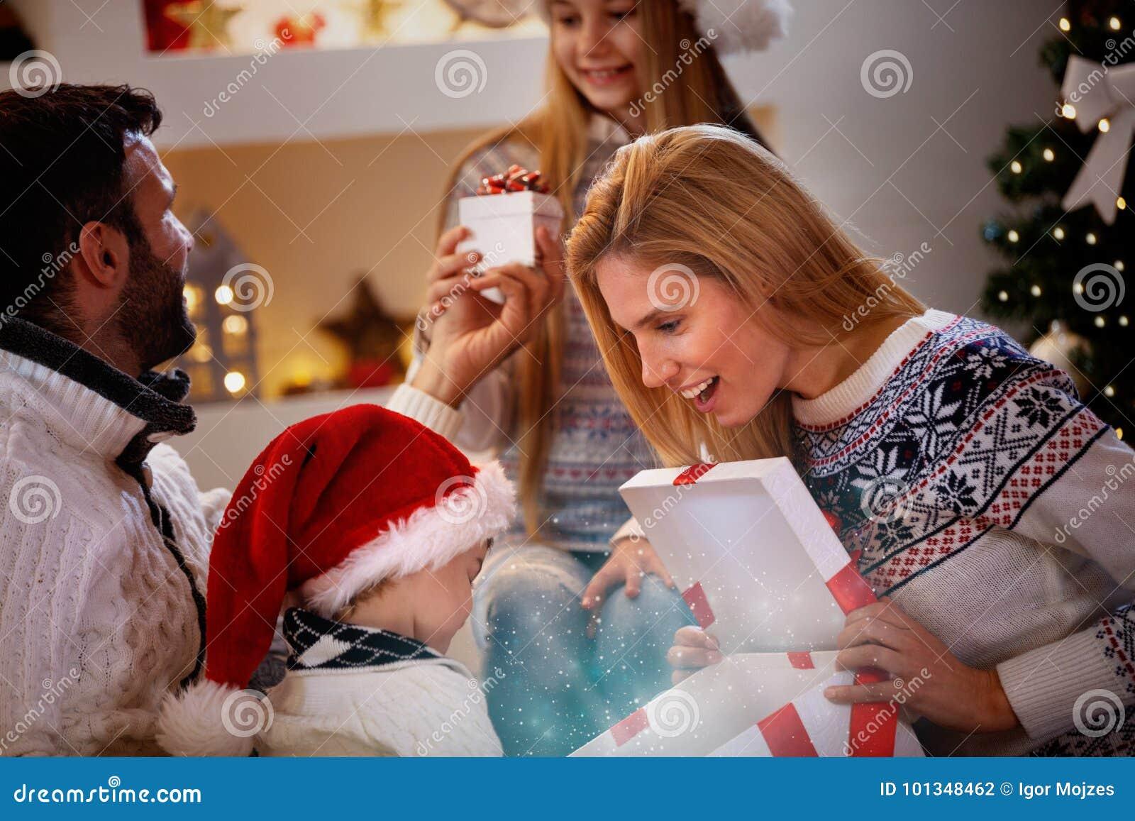 Magical Christmas - family enjoying in Christmas present