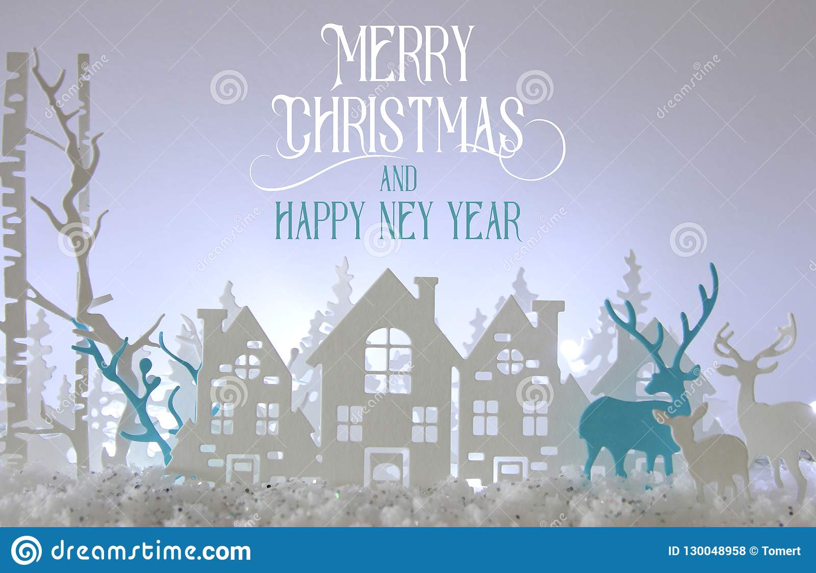 Magical Christmas paper cut winter background landscape with houses, trees, deer and snow in front of white lights background.