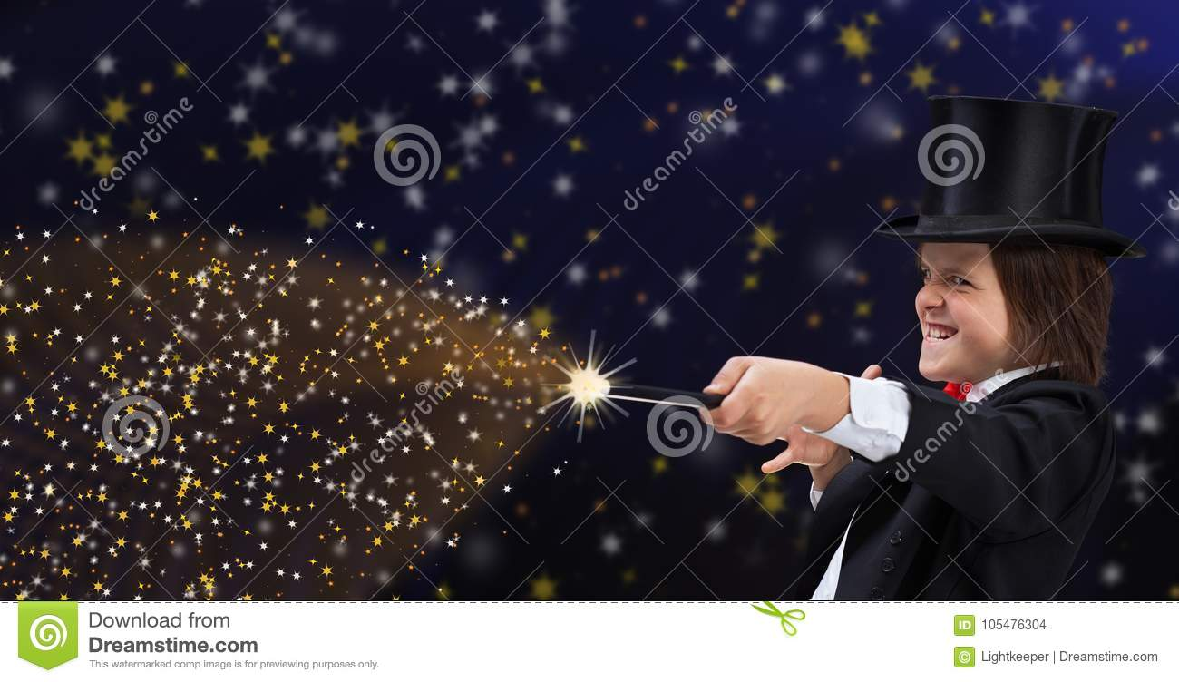 Magician boy with hardhat pointing to copy space with magic wand