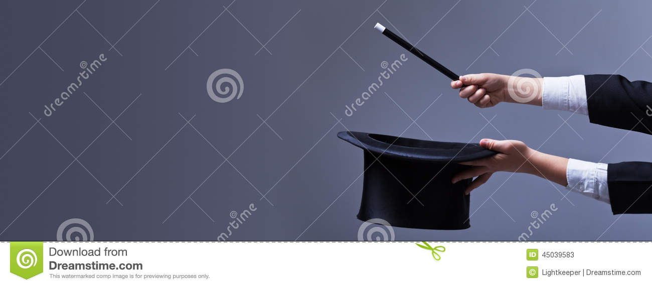 Magician hands with hat and magic wand