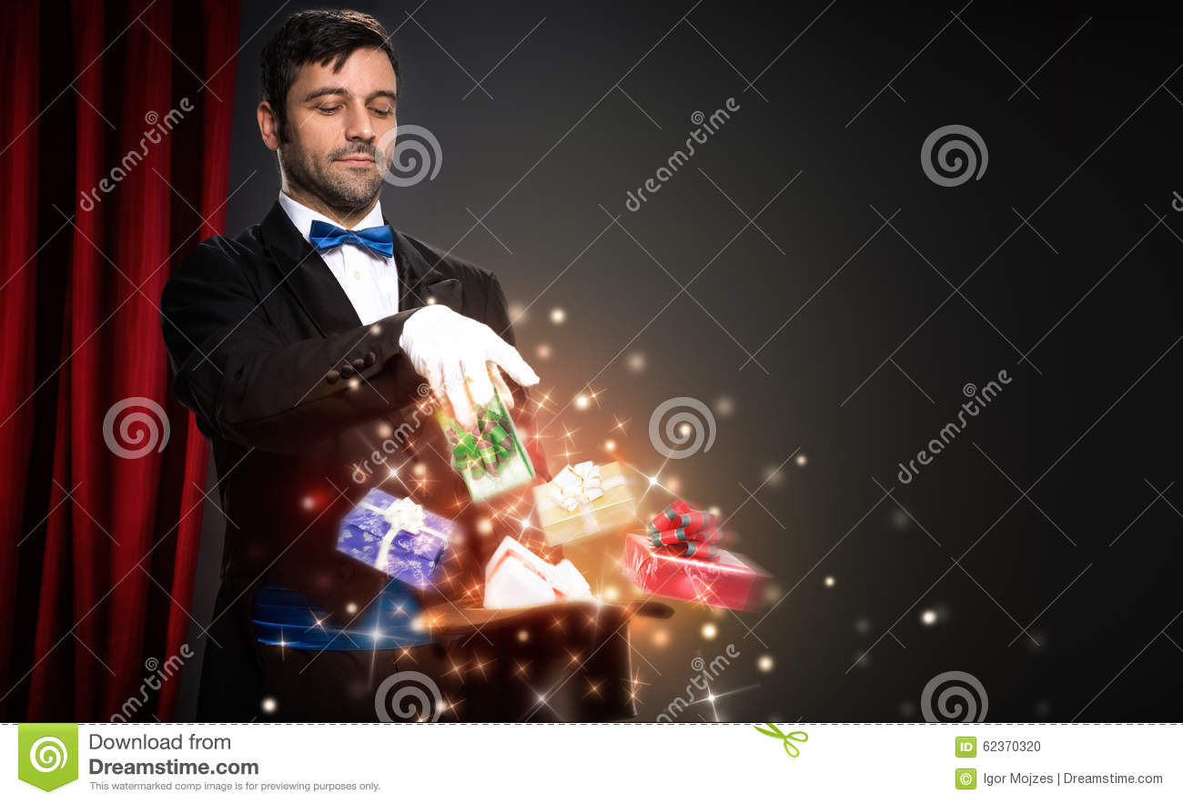 magician with magic christmas box stock photo
