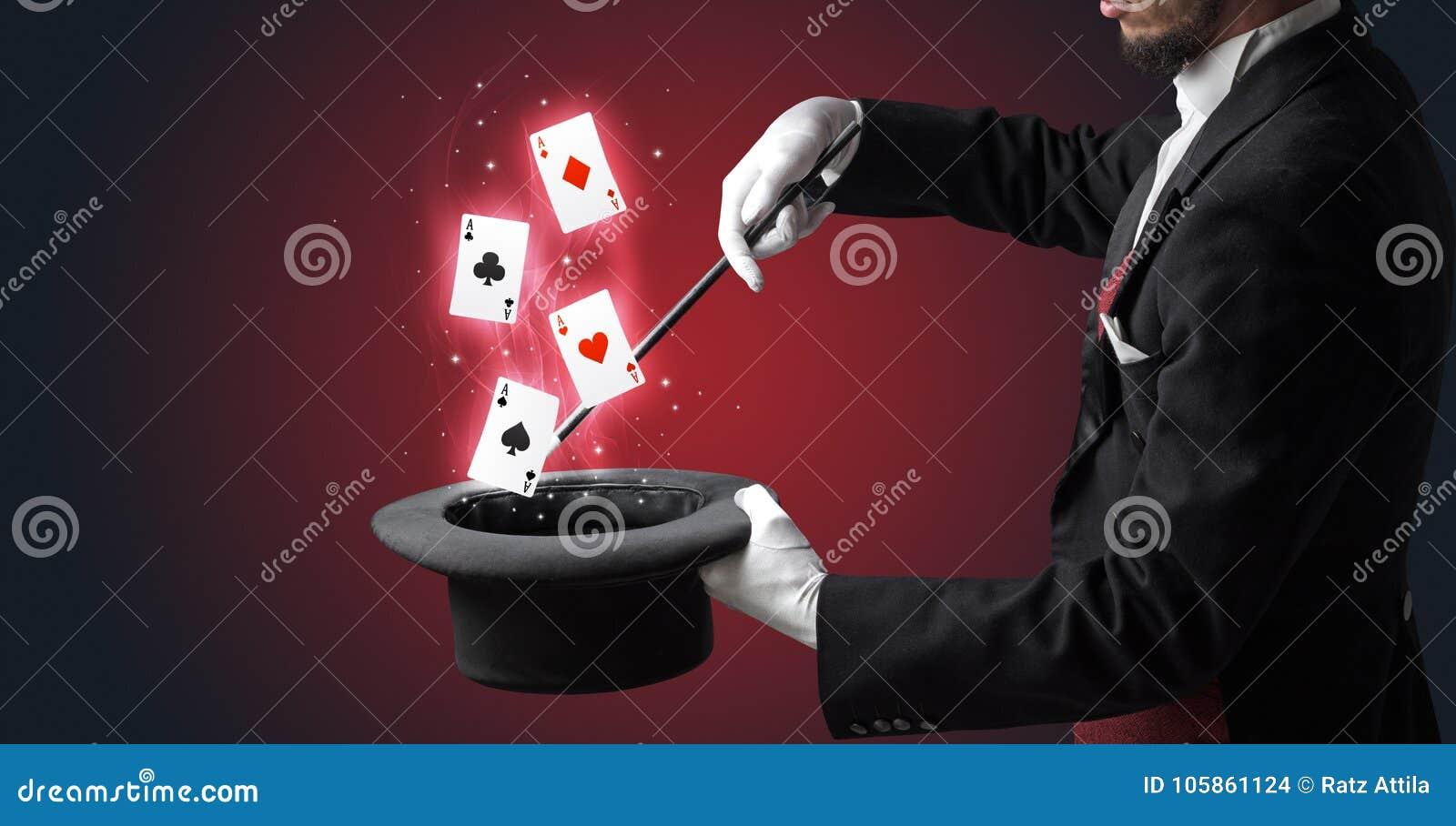 Magik robi sztuczce z różdżką i karta do gry