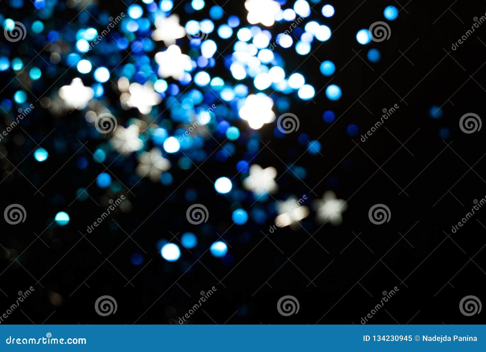 Magische lichtenkerstmis bokeh op zwarte achtergrond