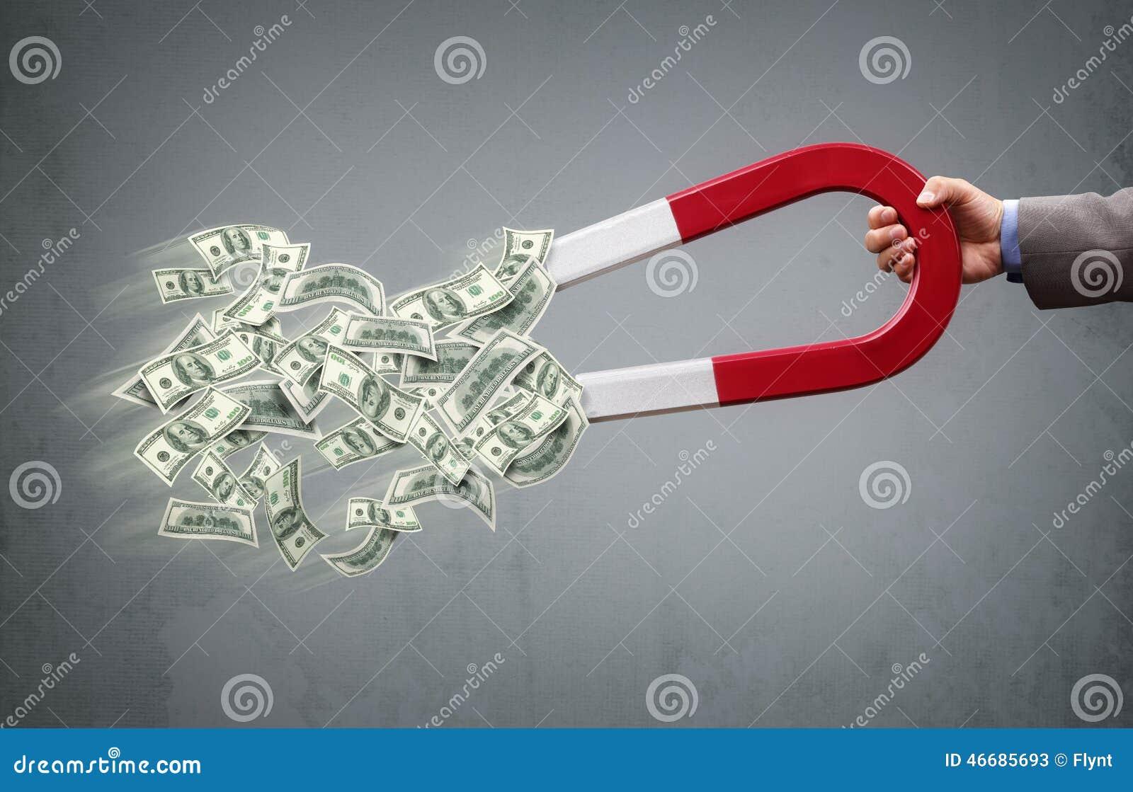 Magnet- und Geldzeichen getrennt auf weißem Hintergrund