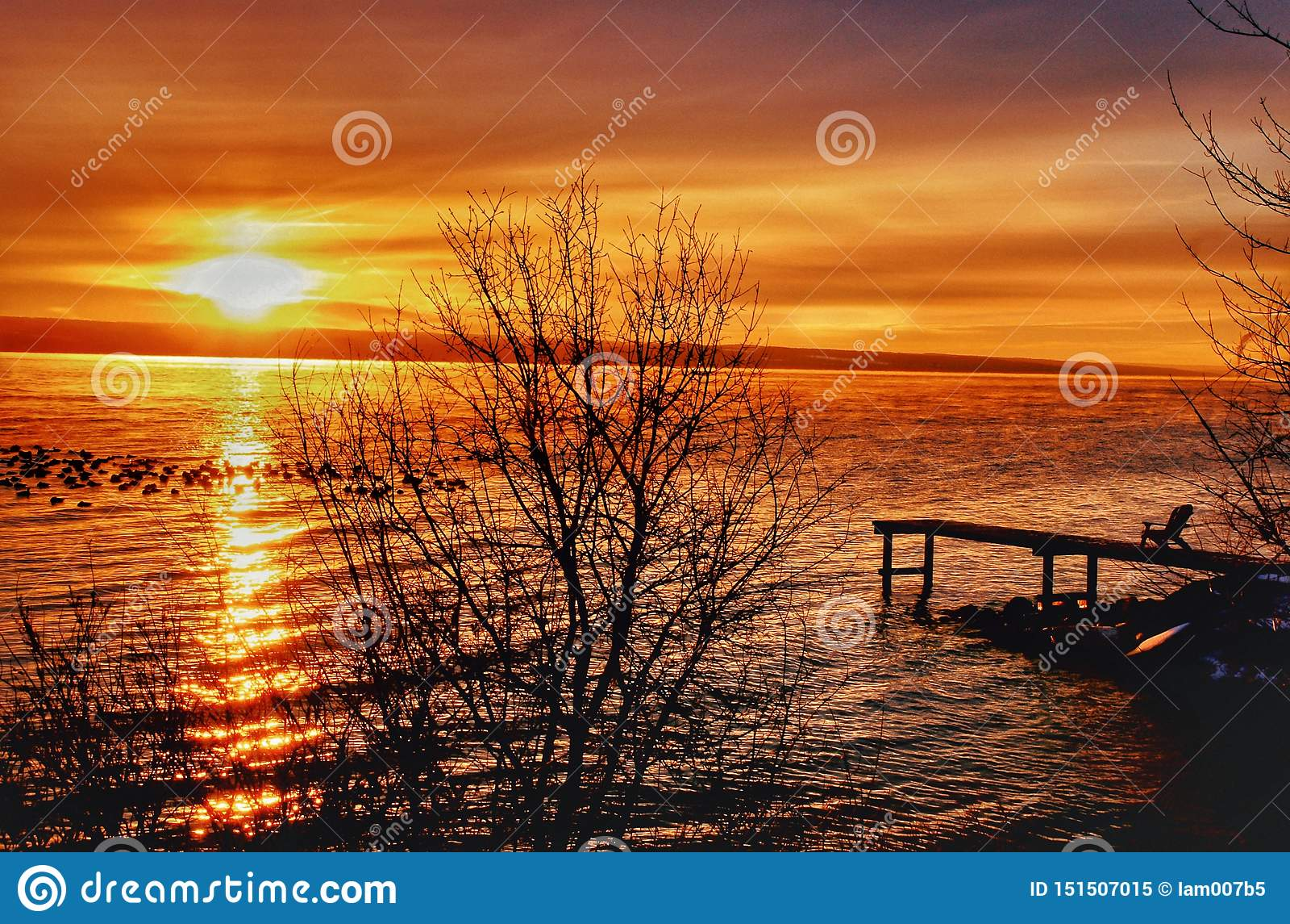 MAGNIFICENT LAKE SUMMER SUNSET ON HORIZON