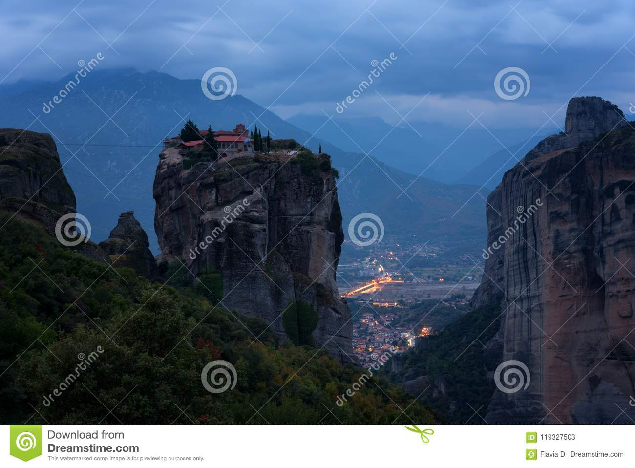 Magnificent nightscape. Monastery Holy Trinity, Meteora, Greece. UNESCO world heritage Site. Epic landscape with temple at t