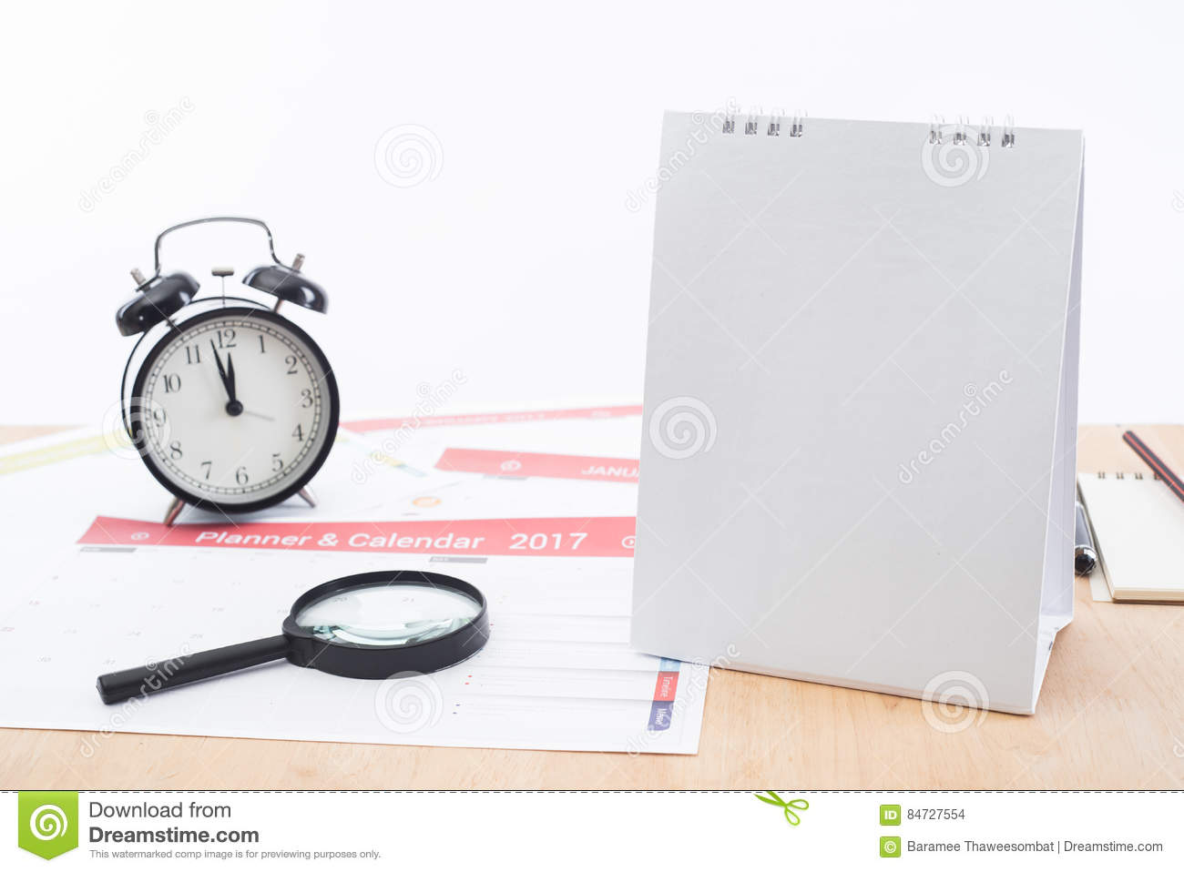 magnifier and clock with business calender planner 2017 on desk