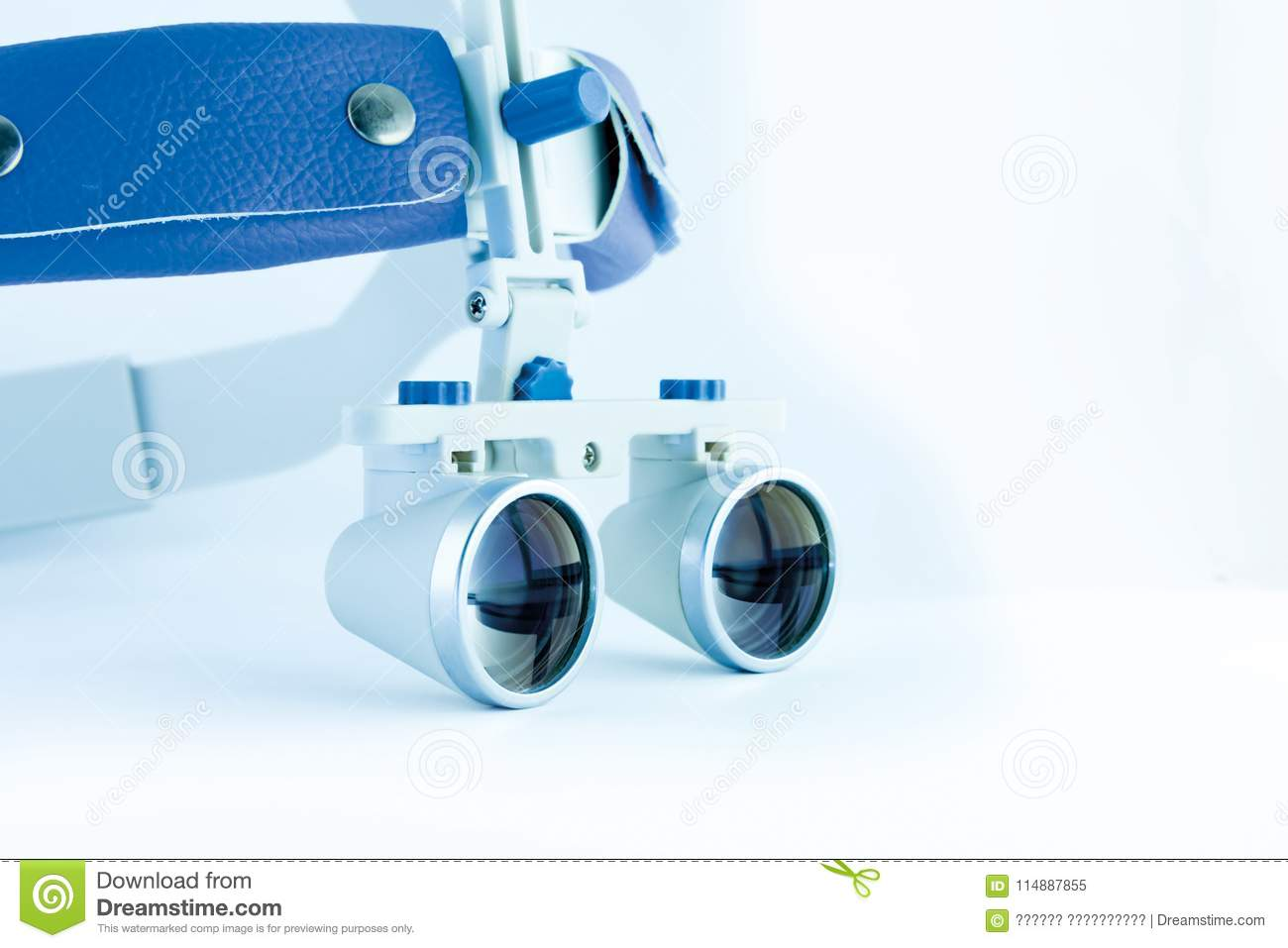 443daed68d42 Magnifying binocular glasses close-up. Dental instruments in the clinic.  The concept of new technologies in dental practice