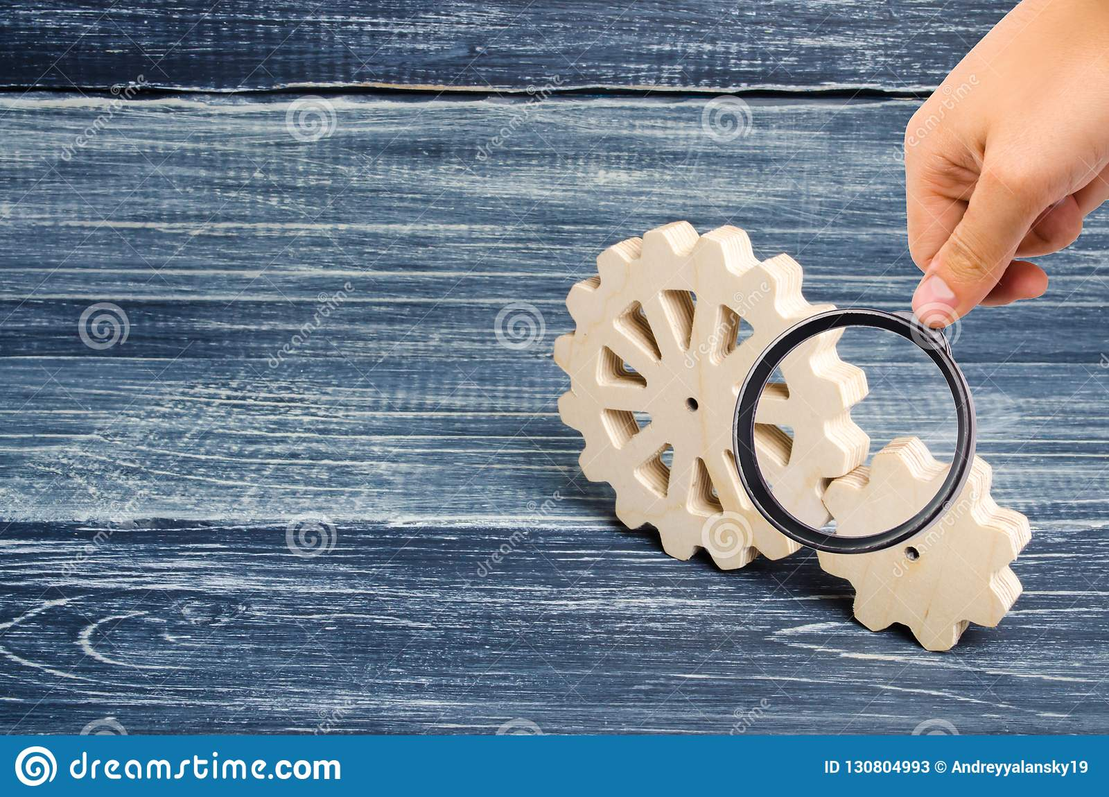 Magnifying Glass Is Looking At The Gears Of Wood Stand On A