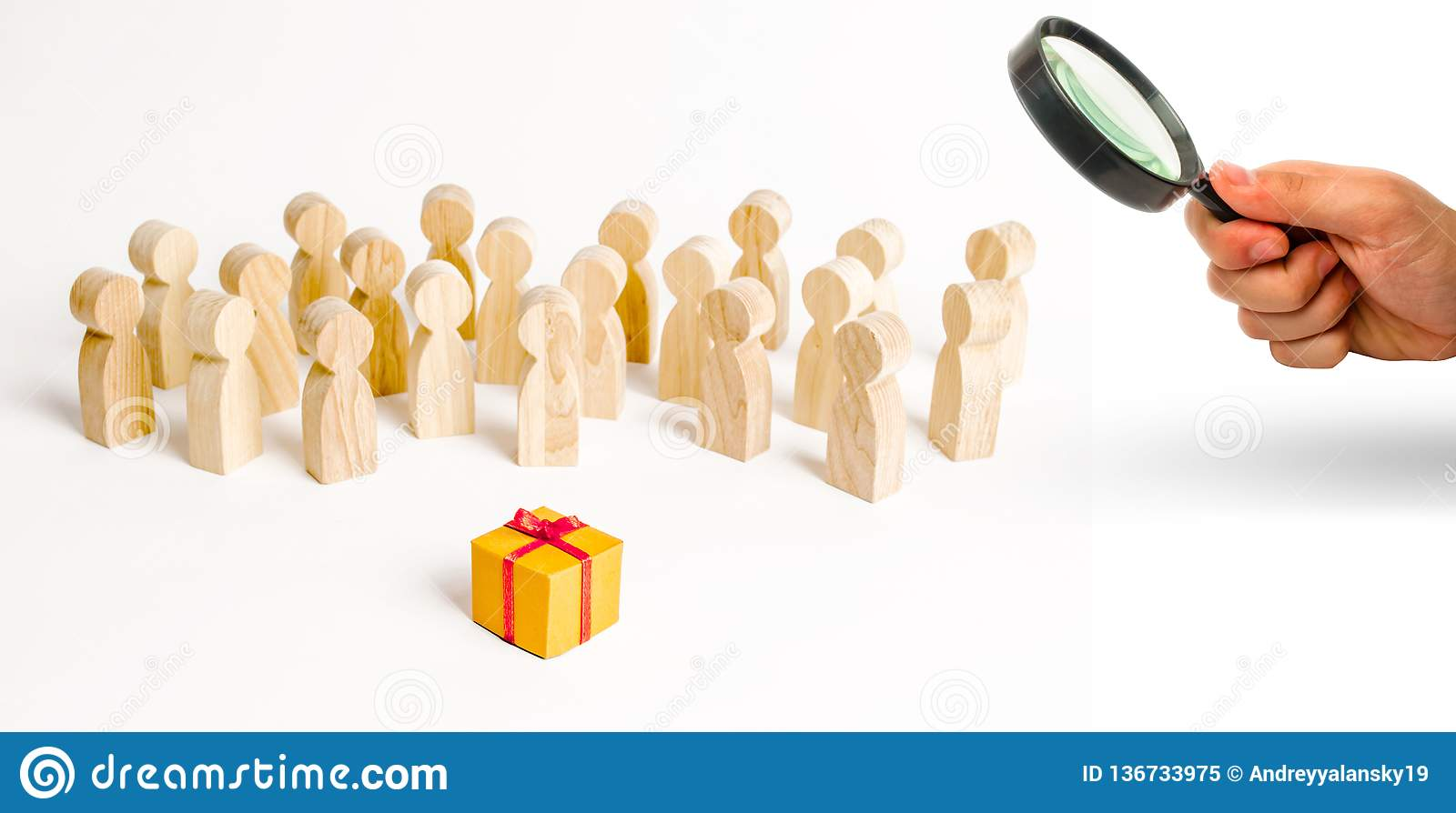 Magnifying glass is looking at the large group of people looking at a gift. The concept of choosing a good gift, a limited number