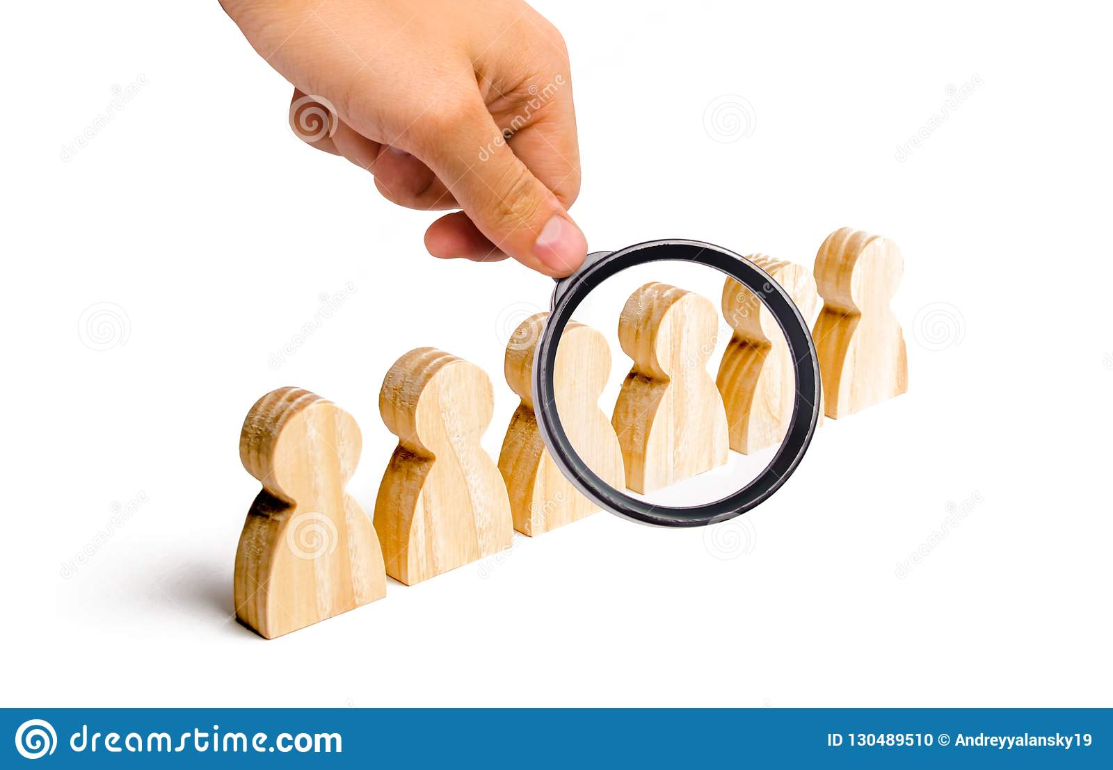 Magnifying glass is looking at the People stand in a formation on a white background. Discipline and order, submission.