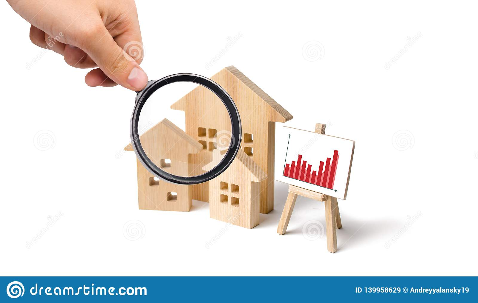 Magnifying Glass Is Looking At The Wooden Houses With A Stand Of