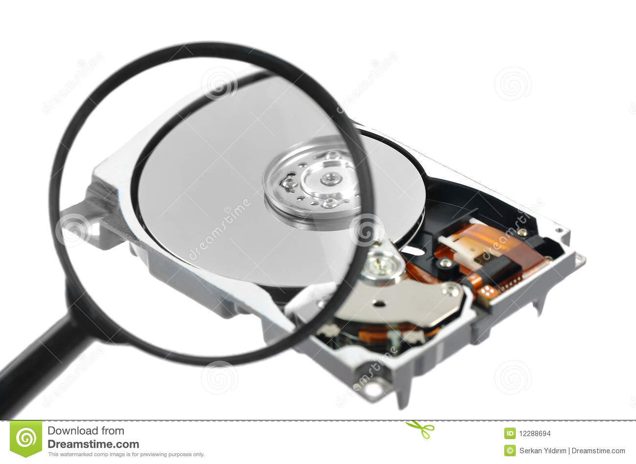 Glass Hard Drive : Magnifying glass over a computer harddrive stock images