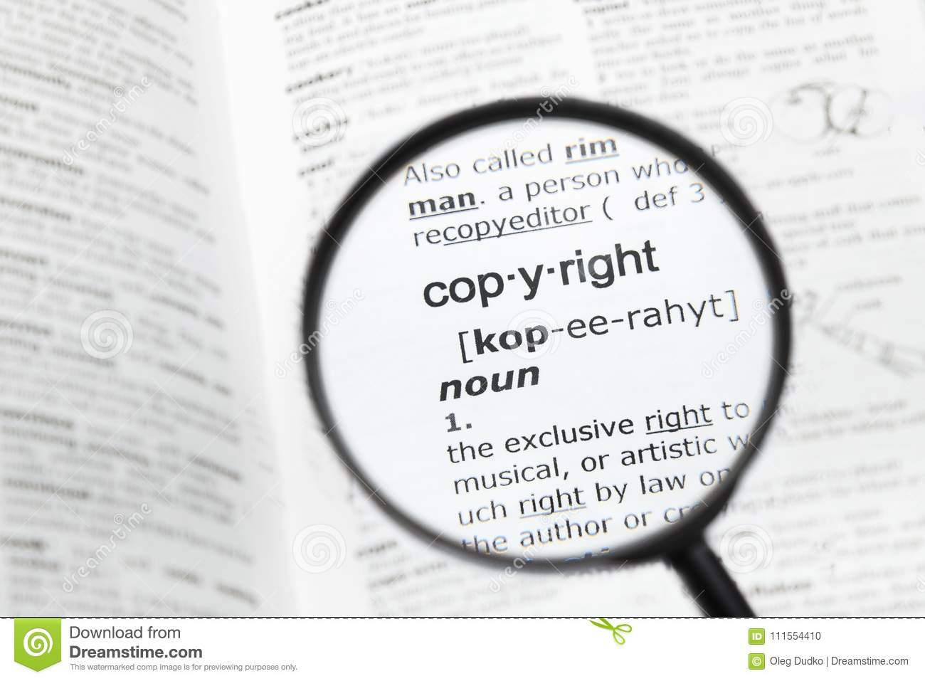 magnifying glass over the definition of `copyright stock photo