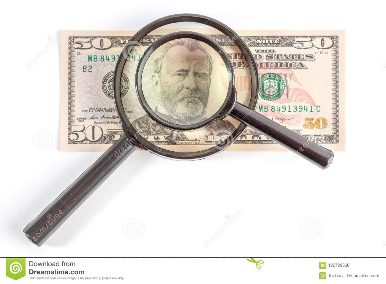 Magnifying glass placed on Ulysses S. Grant portrait.