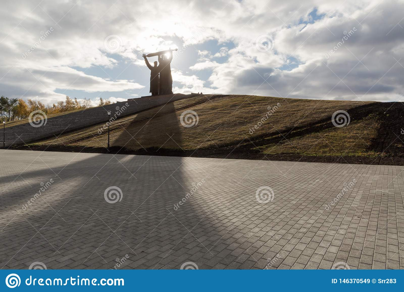 MAGNITOGORSK, RUSSIA - OCTOBER, 2018: Monument Rear-front a famous sculpture and Eternal flame in granite flower