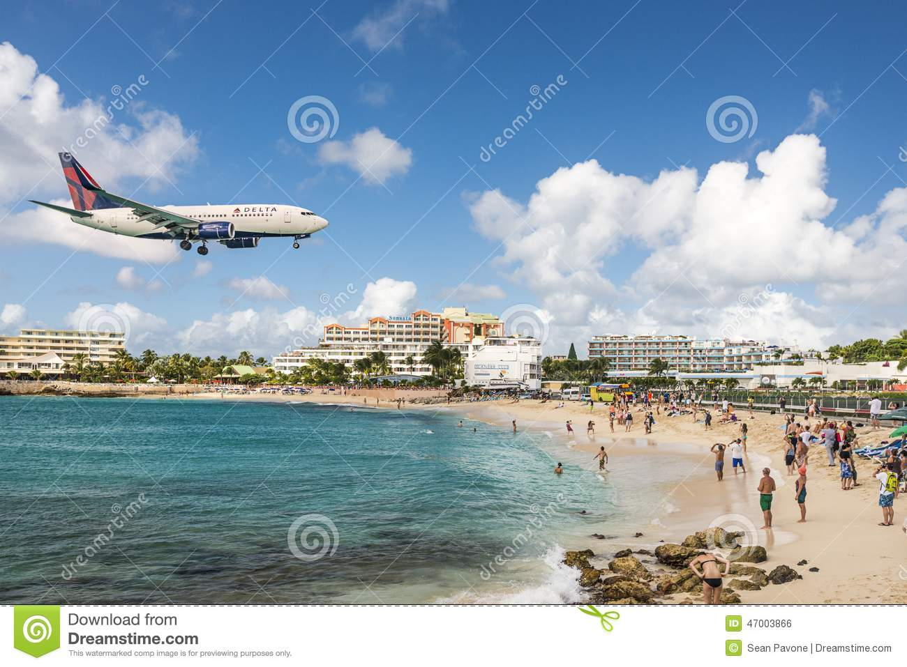 PHILIPSBURG, SINT MAARTEN - DECEMBER 30, 2013: A jet approaches ...
