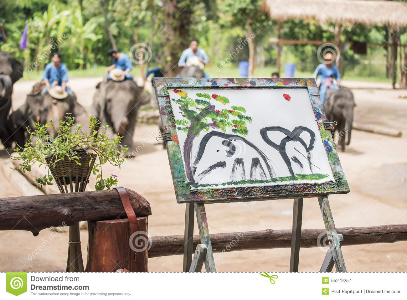 Mahout train elephant drawing a picture.