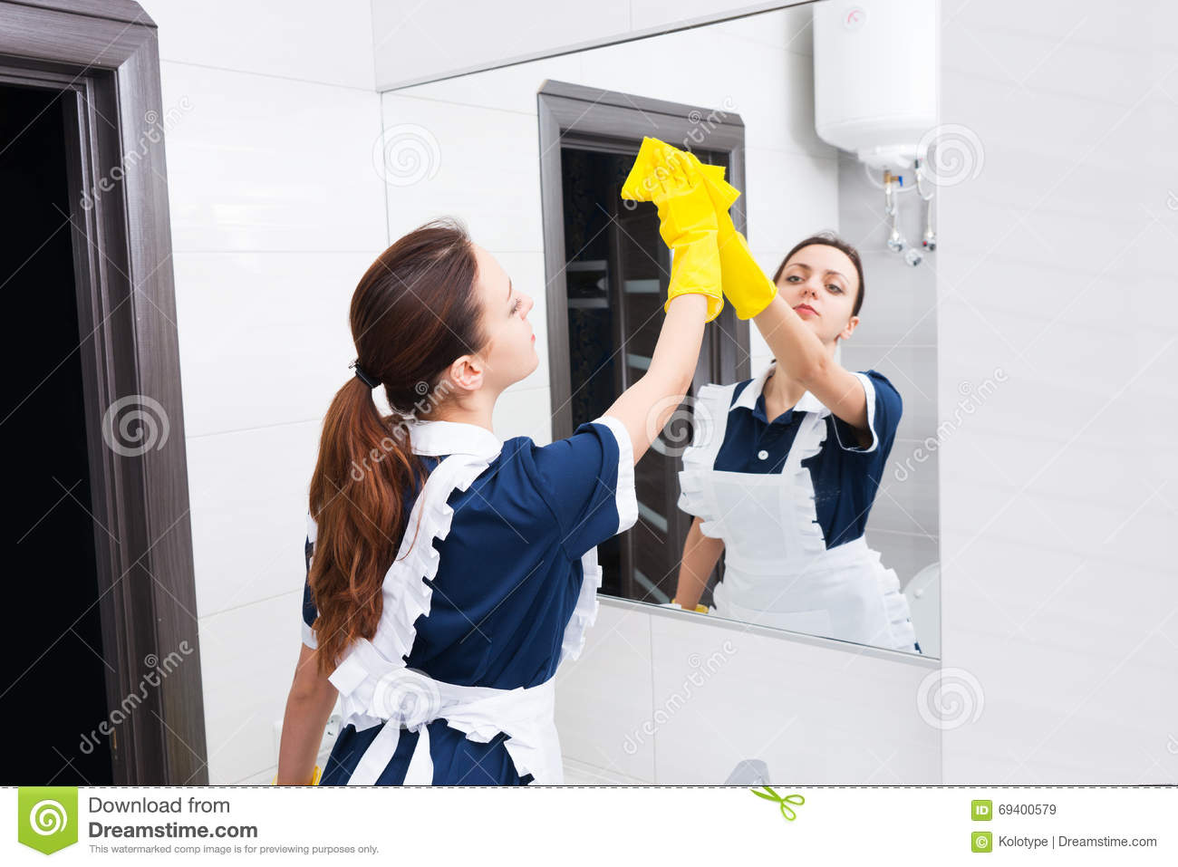 Maid Cleaning Bathroom Mirror With Sponge Stock Image Image Of - How to clean bathroom mirror