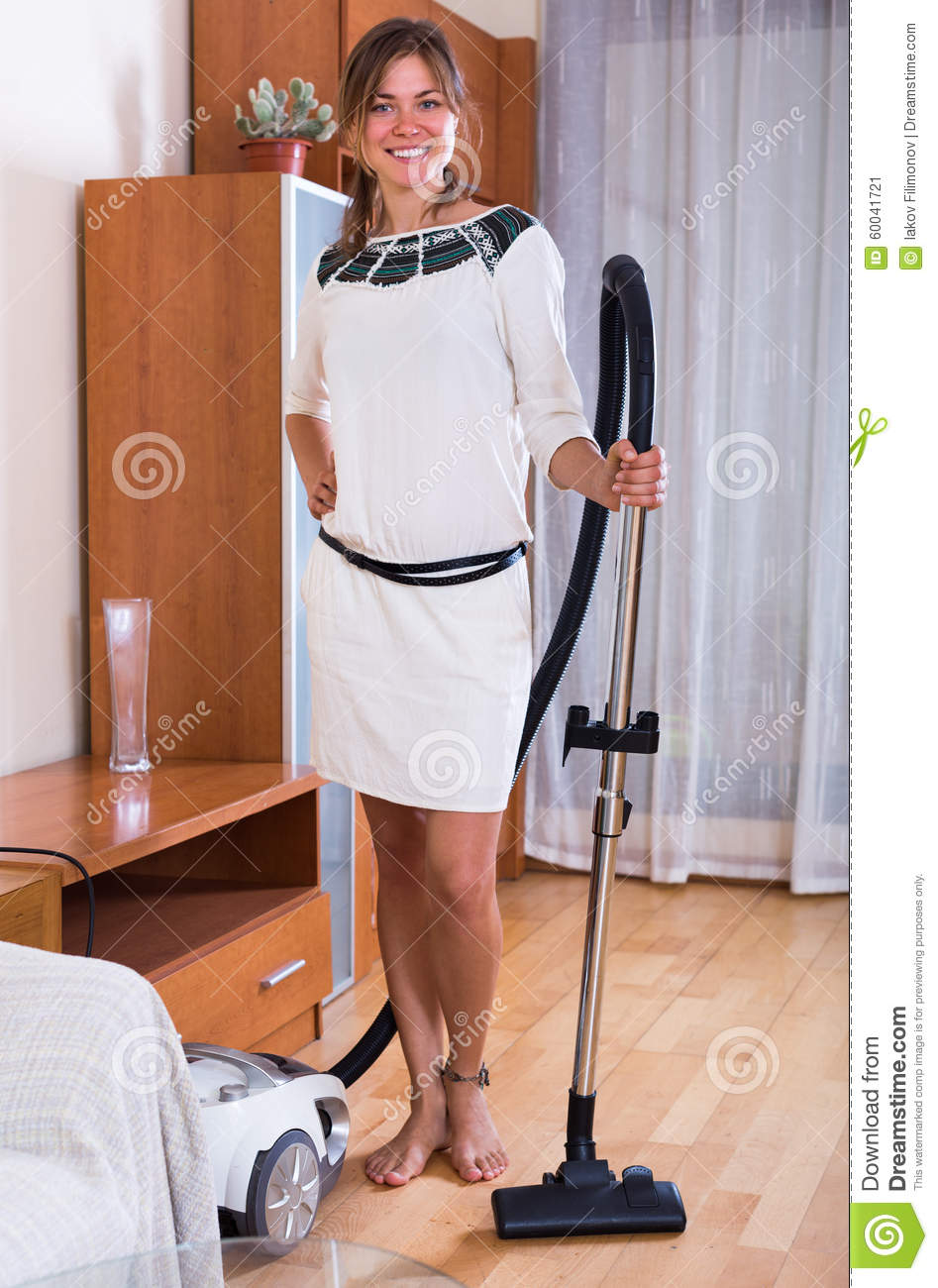 Maid Doing Regular Clean Up And Using Hoover Stock Image