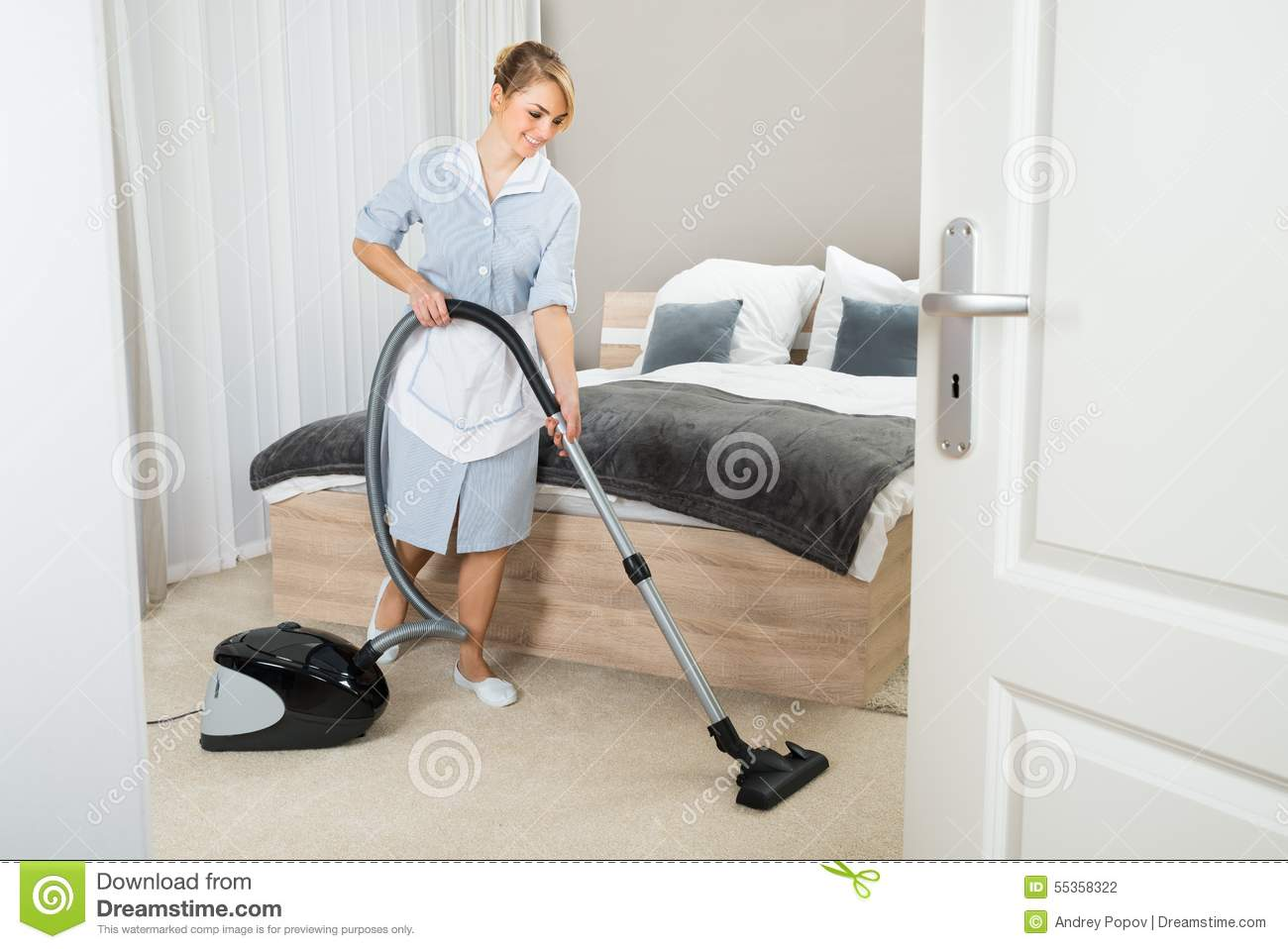 Maid With Vacuum Cleaner In Hotel Room Stock Photo Image