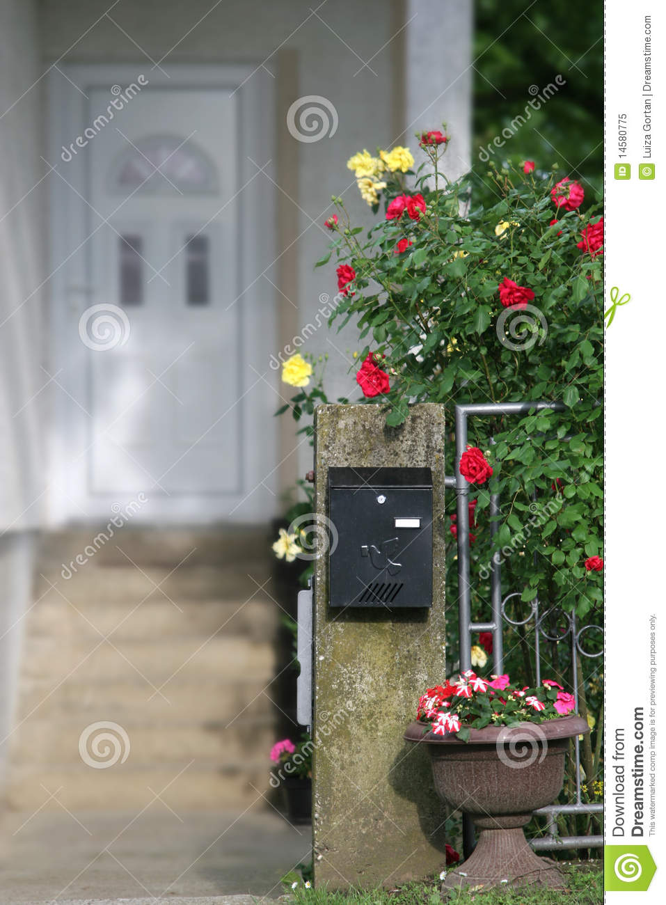 mailbox and flowers in front of a house stock image. Black Bedroom Furniture Sets. Home Design Ideas