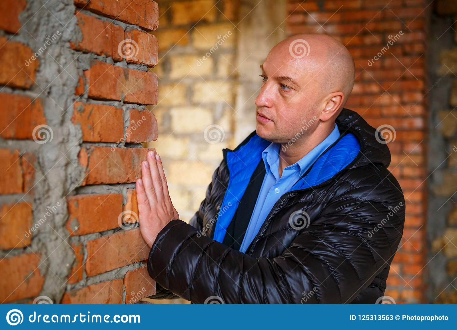 The main Builder checks the quality of brick laying