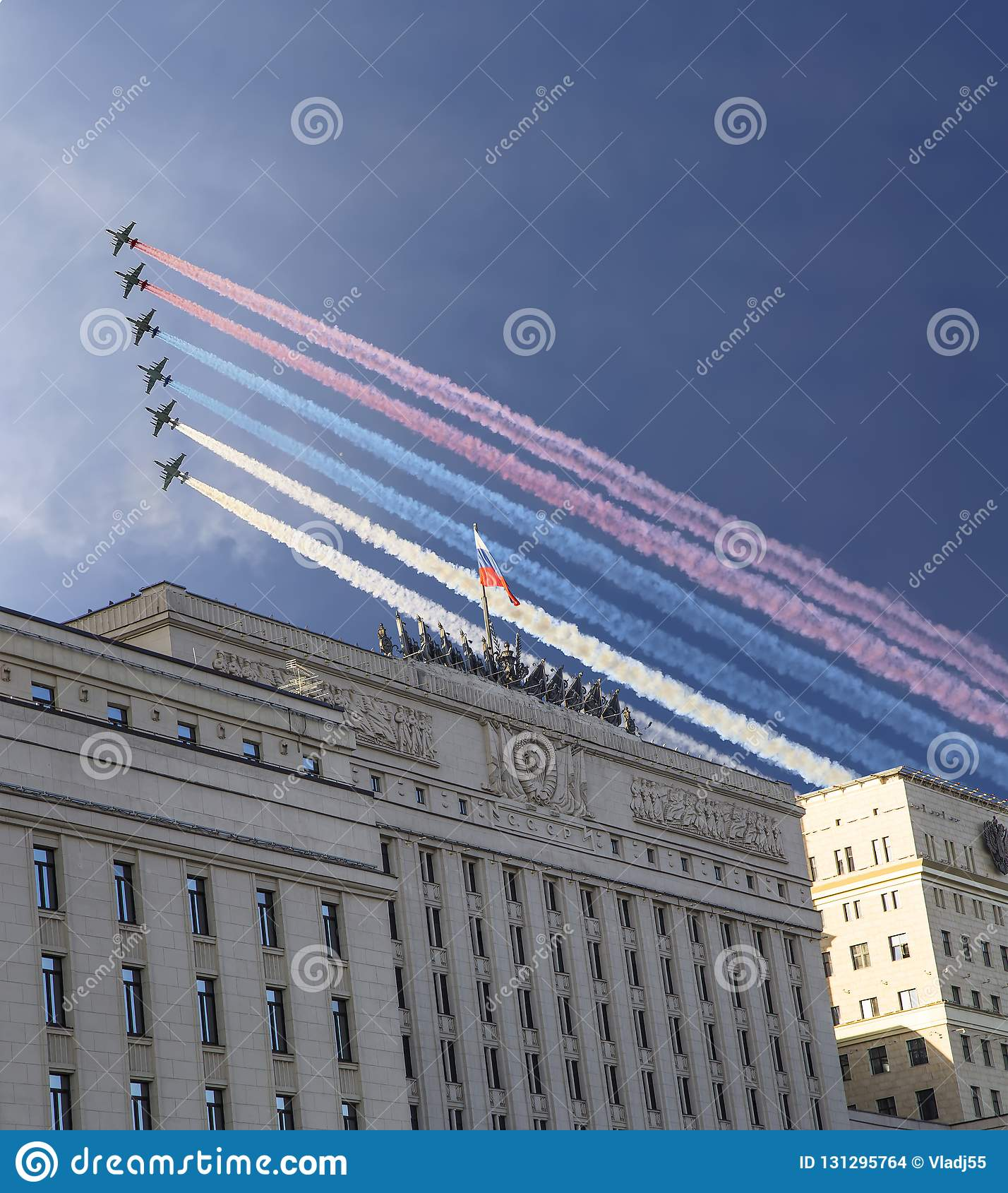 Main Building of the Ministry of Defence of the Russian Federation and Russian military aircrafts fly in formation, Moscow, Russia