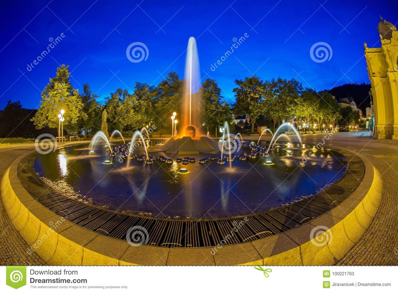 Main colonnade in the small west bohemian spa town Marianske Lazne Marienbad and singing fountain at night - Czech Republic