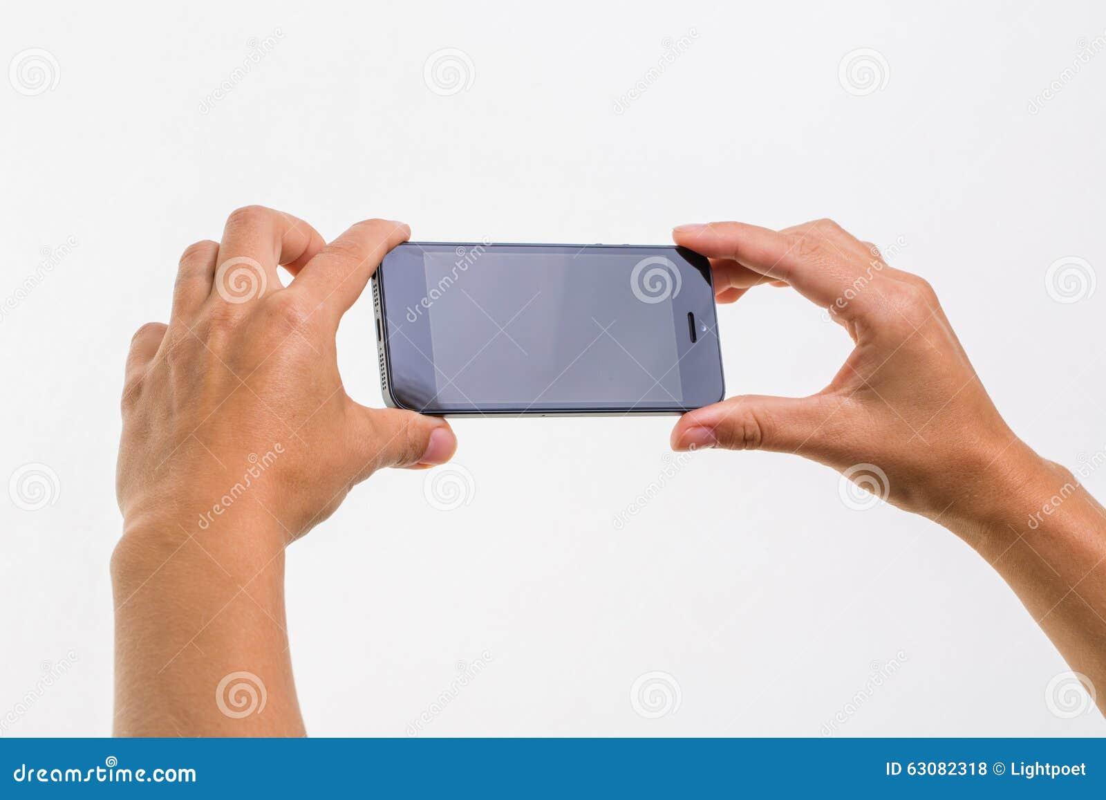 Download Main Femelle Tenant Un Téléphone Intelligent Photo stock - Image du blanc, propre: 63082318