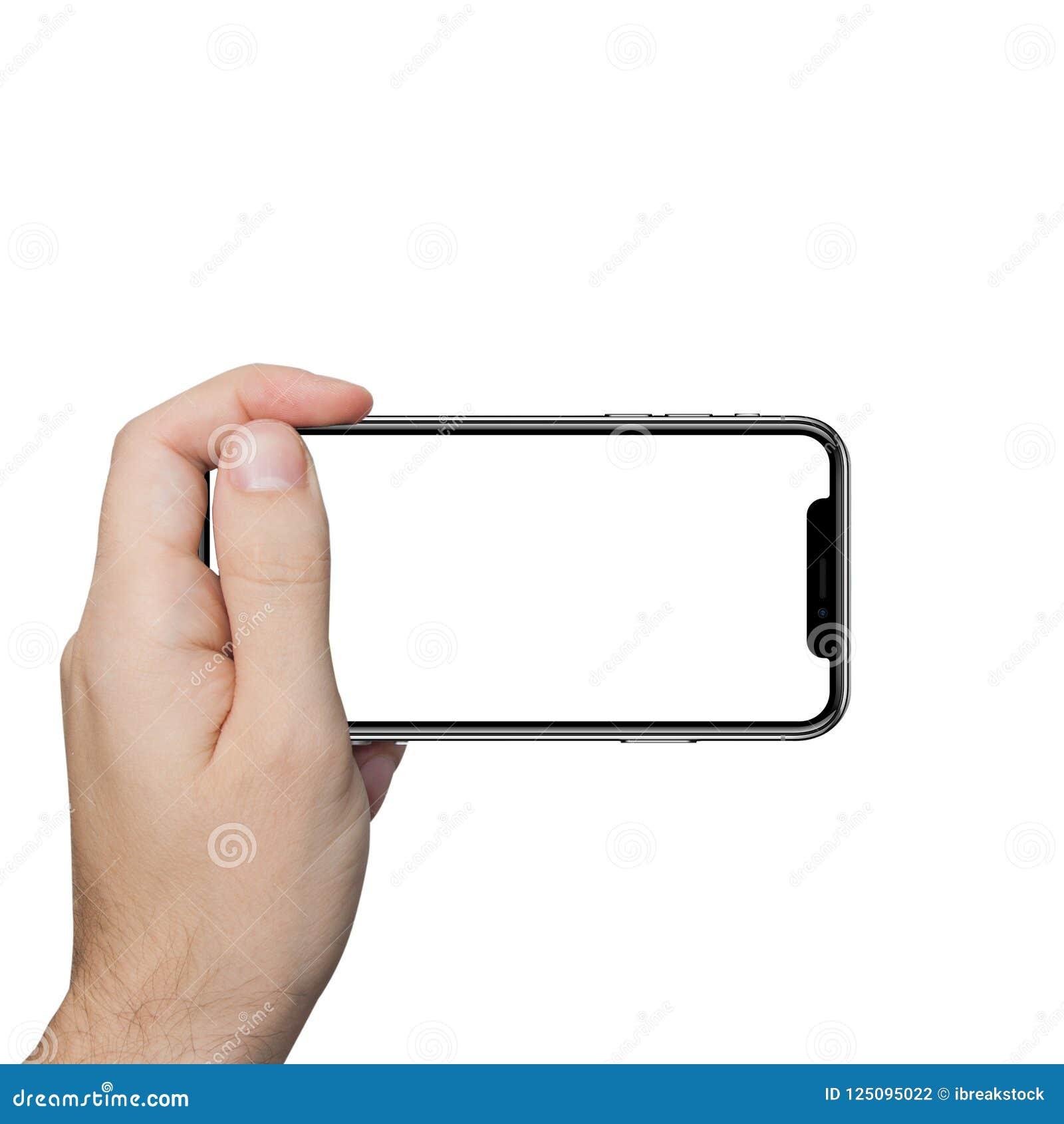 Main masculine d isolement tenant le contact de comprimé de téléphone