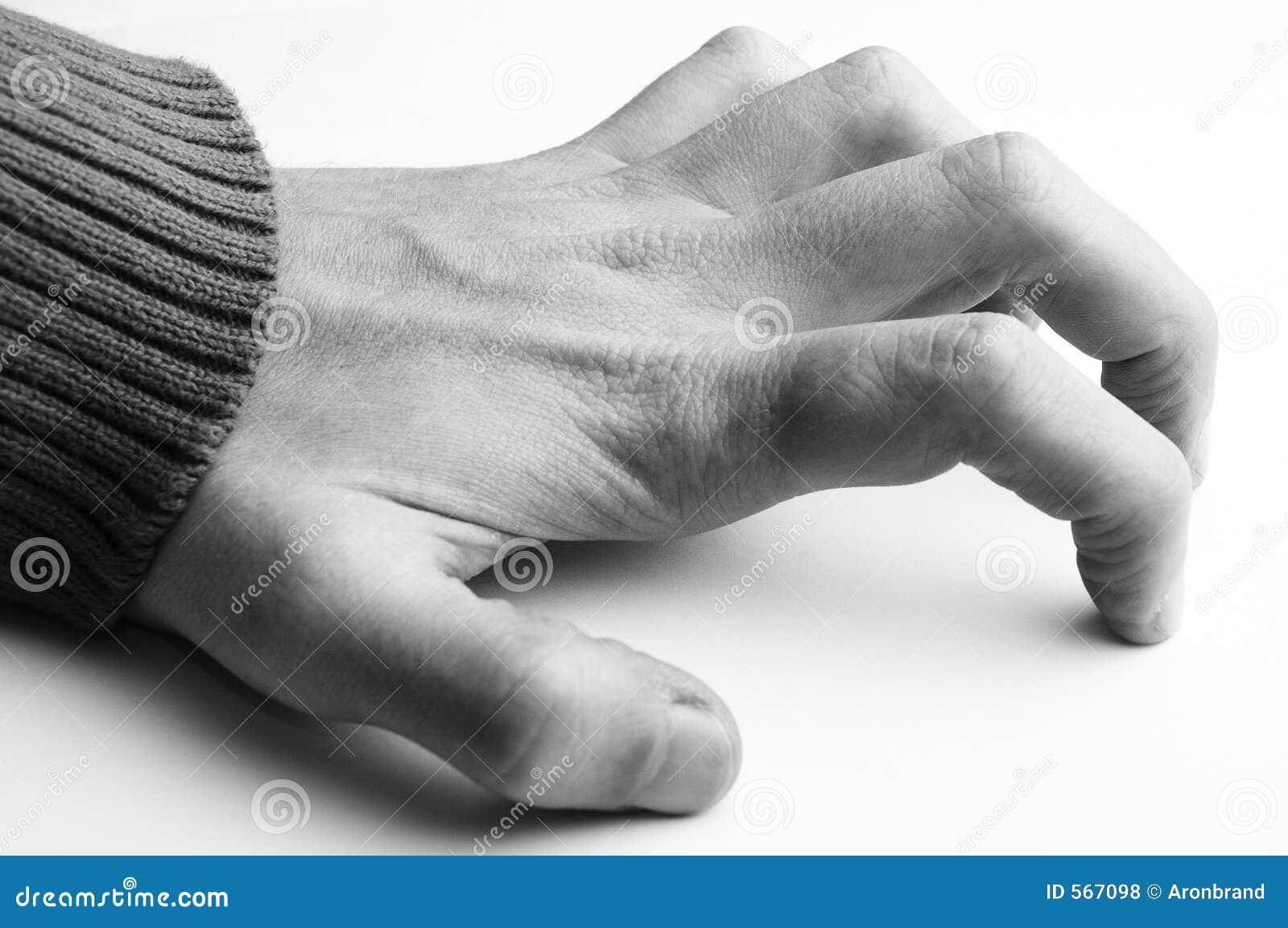 Main sur le fond blanc
