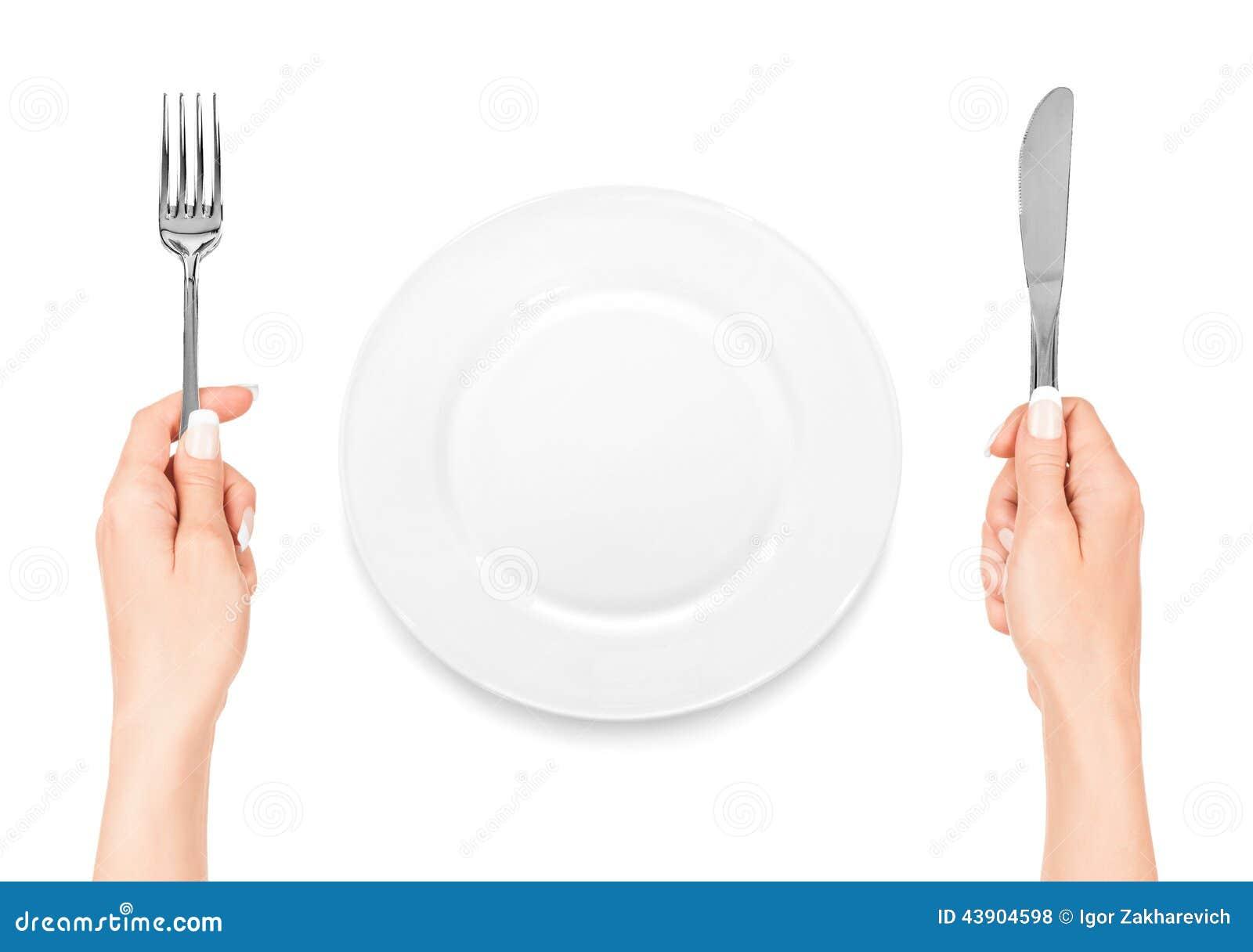 Main tenant la fourchette et le couteau avec le plat photo - Les petites assiettes la fourchette ...