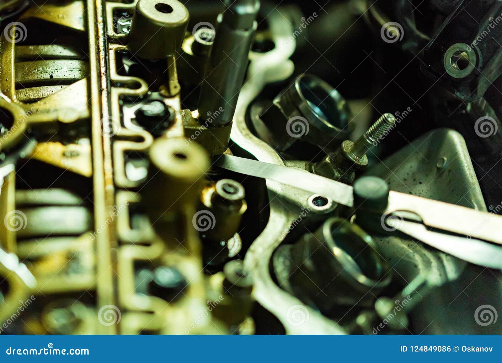 Maintenance Check And Adjust Valve Lash In Car Engine Stock Photo