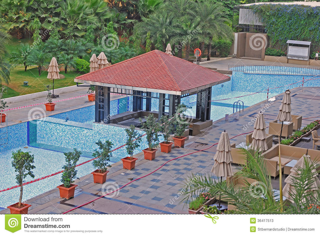 Maintenance of swimming pool stock photos image 36417513 - Hotel with swimming pool on balcony ...