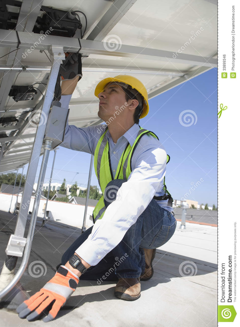 Maintenance Worker Installing Solar Photovoltaic Panels