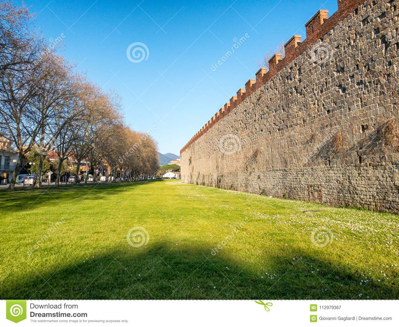 Majestic ancient medieval walls of Pisa with gardens, Tuscany -