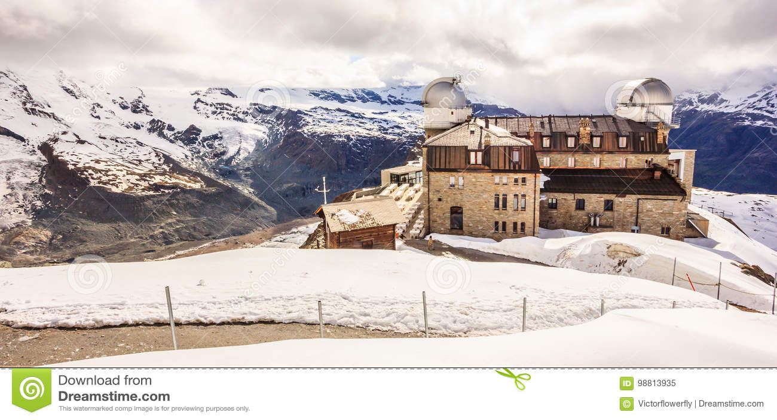 Majestic Dreamy View of snowy Gornergrat station and Matterhorn shrouded with clouds, Zermatt, Switzerland, Europe