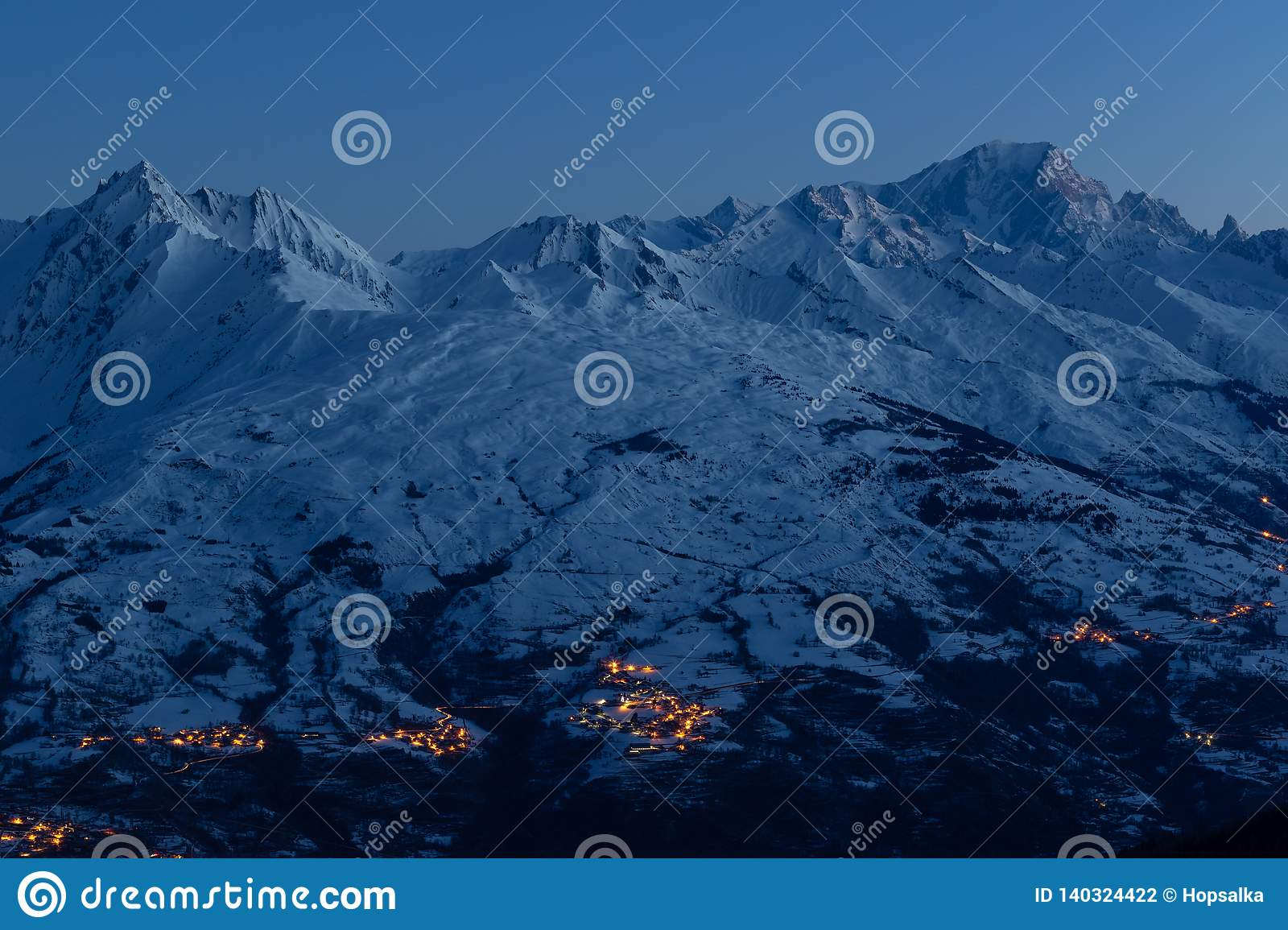 Majestic mountain Mont Blanc and snow covered mountains just before sunrise. View from La Plagne ski resort in French Savoy Alps