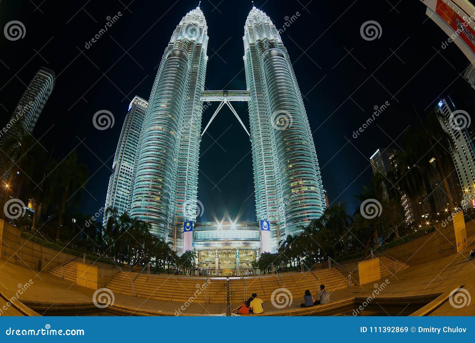 Majestic night view to the Petronas twin towers and surrounding buildings in Kuala Lumpur, Malaysia.
